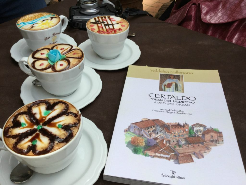 sitting at the outside tables studying up on Certaldo